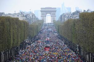 Runners clog the Champs-Elysees during the Paris Marathon in April.