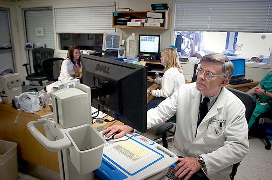 Shands Jacksonville Professor of Surgery and Pediatric Dr. Joseph Tepas III using the EPIC system that was installed in January.