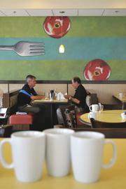 Patrons Barney Smith, left, and Mark Farrell discuss business over breakfast at First Watch in Jacksonville Beach. The restaurant is the chain's first in Northeast Florida.  First Watch intends to open a second restaurant in Mandarin in September.