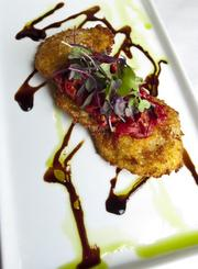 Fried green tomatoes layered with goat cheese and topped with red pepper jam.