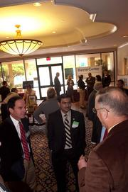 Florida Department of Transportation Secretary Ananth Prasad, center, talks with attendees before the event.