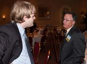 Global Trade Symposium Speaker Marty Burr speaks with an attendee before the start of the event.