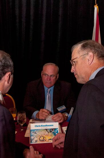 Chris Kauffmann, chief operating officer of the Jackosnville Port Authority, talked with attendees from Tuesday's Global Trade and Transporation Symposium before the event began.
