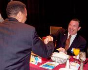 Holland and Knight Managing Partner Daniel Bean shares a laugh prior to the start of the 2012 Global Trade and Transportation Symposium.
