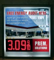 Harbinger's digital LED signs can be controlled by a remote control and change text or prices like on this gas station sign automatically.