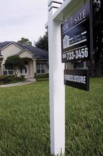 Stock turmoil could boost real estate
