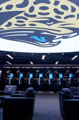 A large 8-foot by 10-foot Jaguars logo covers the ceiling in the middle of the locker room. It's printed on a 50 percent translucent seamless polyester UV-cured fabric, mounted on a 16-foot by 26-foot elliptical ceiling display back-lit with more than 500