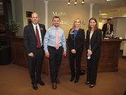Mathis & Murphy PA hosted the Jacksonville Business Exchange Jan. 17.  Attorneys James T. Murphy, left, and Jill F. Bechtold, far right, pose here with two guests. Guests socialized while enjoying appetizers and an amazing view.