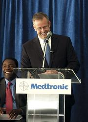 Jacksonville Mayor Alvin Brown and Mark Fletcher of Medtronic share a laugh during the groundbreaking.