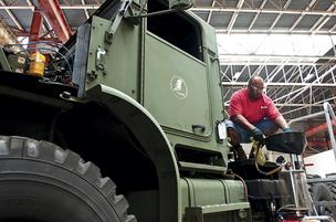 Honeywell tech Douglas Freeman works on a naval vehicle at the Marine Corps Blount Island Command.