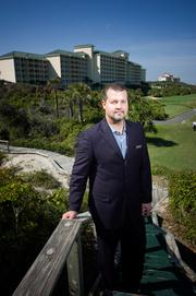 Omni Amelia Island General Manager Paul Eckerts stands in front of the resort's 249-room hotel.