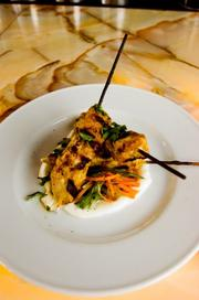 Moroccan-spiced niman ranch pork skewers on a Black Hog Farm's shaved carrot and yogurt salad.