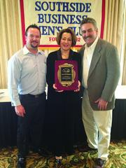 Galina Schott presented Duckworth Construction Co. with the Southside Businessmen's Club's Small Business of the Year Award. From left, Mark Jackson, Galina Schott and Hank Duckworth.