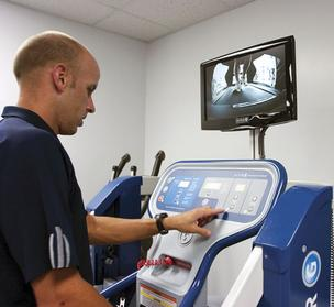 Jacksonville Orthopedic Institute physical therapist and athletic trainer Andrew Heideman demonstrates usage of the AlterG anti-gravity treadmill at the San Marco location. JOI only uses the treadmill for patients, but refers athletes who are interested in the technology to a partner, Paul McRae's Personal Running Solutions gym in San Marco.