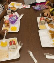 Area elementary students eat school meals. 55 percent of Duval County Public School students receive free or reduced lunch.