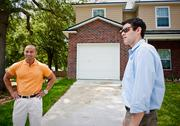 Joe Dela Cruz and Greg Cohen in front of one of Cruz's homes. He uses Cohen's company as his property management company.