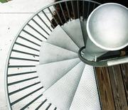 A spiral staircase to the roof is made of recycled materials.