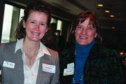 Stacy Roussel, left, and Cathryn Hagan at the Jan. 8 World Affairs Council luncheon at The River Club.