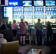 Aloft Tapestry Park gather around the bar during the hotel's happy hour.