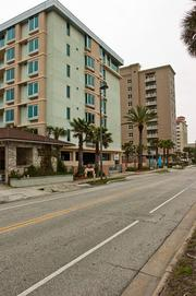 The Water's Edge condominiums in Jacksonville Beach, left, are one of many beachfront properties that are selling for about half the original  asking price.