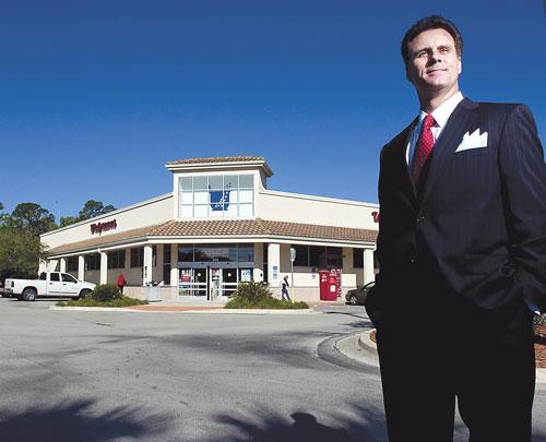 Patrick Whitney, an associate at Marcus & Millichap Real Estate Investment Services, stands in front of a Walgreens in Julington Creek that is on the market for $5.3 million. Private investors have shown renewed interest in solid commercial real estate.