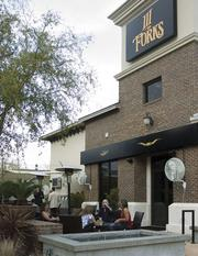 Patrons of III Forks enjoy the patio at the Tapestry Park location.
