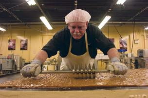 Reggie Taylor prepares the goods at the Whetstone Chocolate factory, which is expanding production.