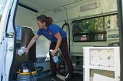 Aussie Pet Mobile Groomer Amy Hendren cleans the van after a day on the road. Hendren averages four to six stops per day, grooming all kinds of animals.