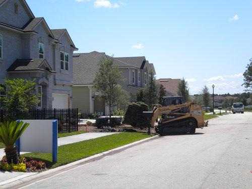 A construction crew lays down sod at a home under construction at Greenland Chase on the Southside.