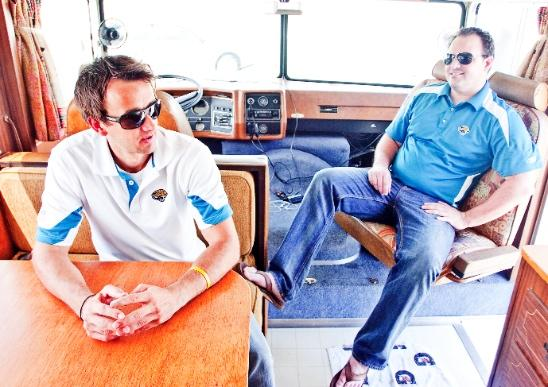 Trip Gillander, left, and Matt Wilcox hang out in the front of the fully restored 1974 Winnebago Chieftain they bought to tailgate at Jaguars home games.