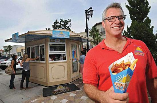 French Fry Heaven founder Scott Nelowet at his kiosk at the St. Johns Town Center.