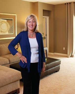 Barbara Moore of The Lennar Corp. is smiling again after a spike in St. Johns County home construction.