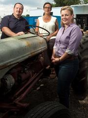 Atlantic International Distributors Inc.'s Chris Harper, left, Mary Maszy, center, and Sissy Warnock.