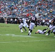 Running back Arian Foster drags Jaguars' defenders for a first down during the second quarter.
