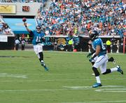 Gabbert throws a pass to wide receiver Cecil Shorts.
