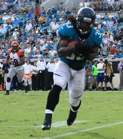 Fullback Greg Jones catching a Gabbert pass.