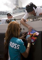 Gold Medalist Sanya Richards-Ross signs an autograph at the Jaguars game against the Texans. Richards-Ross is married to Jacksonville Cornerback Aaron Ross.