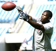 Texans Wide Receiver Andre Johnson catches passes during warmups.