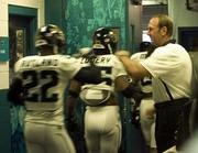 Jacksonville Head Coach Mike Mularkey greets players as they enter for warmups.