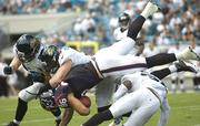 Texans' James Casey tackled by a host of Jaguars for positive yardage.