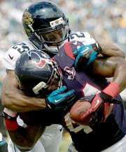 Jaguars Defensive Back Dwight Lowery brings down Ben Tate during Jacksonville's 27-7 loss to Houston.