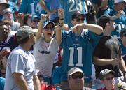 A Jaguar fan reacts to action on the field.