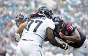 Jaguars Offensive Guard Uche Nwaneri takes on Texans Defensive End Antonio Smith during Houston's 27-7 win at Everbank Field.