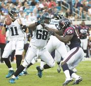 Jaguars Quarterback Blaine Gabbert looks downfield as Guy Whimper(68) protects from Whitney Mercilus (59).