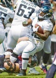 Jaguars Running Back Maurice Jones-Drew is brought down from by Houston's JJ Watt.