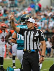 Hochuli, a trial attorney in Arizona, is also known for his large biceps.