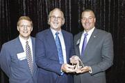 Bill F. Kilgannon (center) of ShayCore Enterprises Inc.The company was No. 3 on this year's list.