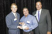 Doug Recker (center) CEO of Colo5 llc.The company was No. 2 on this year's list.