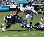 Texans' running back Arian Foster is brought down by cornerback William Middleton and linebackers Russell Allen (50) and Kyle Bosworth (56).