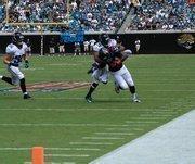 Corner back William Middleton tackles Houston running back Ben Tate.
